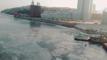 Flying over a frozen river at dawn where people are fishing on thin ice video