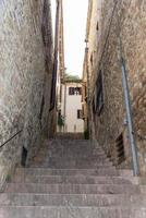Architecture of streets and buildings in the historic center of assisi photo