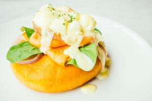 Donut bread with smoked salmon and egg benedict photo