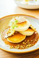 Sweet dessert pancake with banana and sweet sauce photo