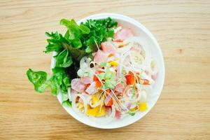 Raw and fresh tuna with vegetable salad photo