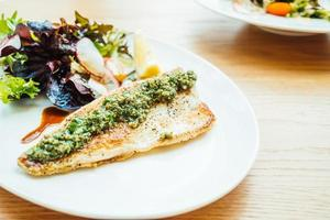 Grilled sea bass fish meat steak with vegetable photo
