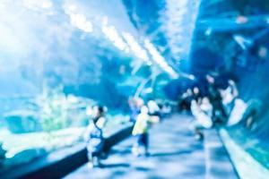 Abstract blur and defocused underwater of aquarium tunnel tank photo