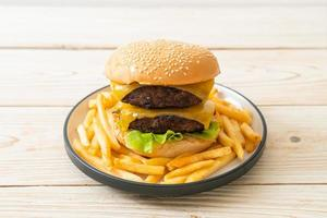 Hamburger or beef burgers with cheese and french fries - unhealthy food style photo