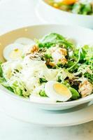 Fresh tuna salad in white bowl photo
