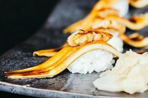 Grilled eel fish sushi with foie gras on top photo