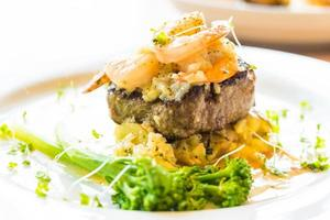 Grilled beef and shrimp or prawn steak photo