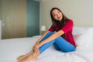 Portrait beautiful young asian women smile happy on bed photo
