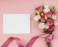 Top view beautiful roses bouquet with empty card. High quality beautiful photo concept