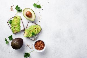 Top view avocado toast breakfast with herbs spices. High quality beautiful photo concept