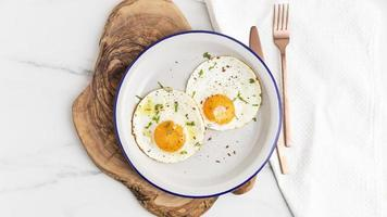 Top view breakfast fried eggs plate with cutlery. High quality beautiful photo concept