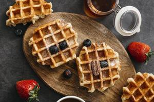 Top view composition tasty waffles. High quality beautiful photo concept