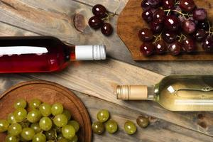 Top view wine bottles with grapes. High quality beautiful photo concept