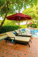 Bed pool around swimming pool in hotel resort - holiday and vacation concept photo