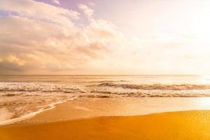 Beautiful and empty beach sea at sunrise or sunset time photo