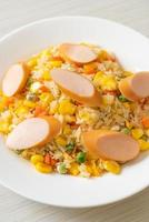 Fried rice with sausage and mixed vegetable photo
