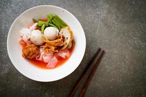 Yen-Ta-Four - Thai Style Noodle with assorted tofu and fish ball in Red Soup - Asian food style photo