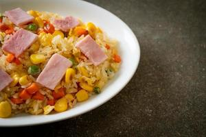 Homemade fried rice with ham and mixed vegetable of carrot, and green bean peas photo