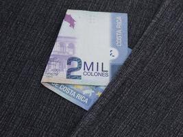 Costa Rican banknote of 2000 colones between blue denim fabric photo