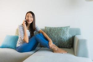 Portrait beautiful young asian woman using or talking mobile phone photo