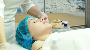 A Cosmetologist Gives a Facial Massage video