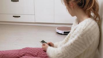 Woman Controls a Robot Vacuum video
