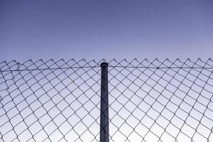 Metal fence with blue sky photo