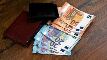 table with euro banknotes and several wallets video