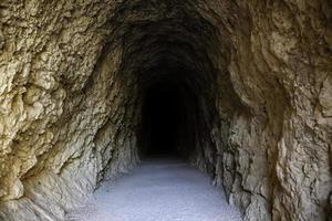 Deep stone tunnel photo