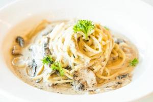 Spaghetti cream sauce with truffle mushroom photo
