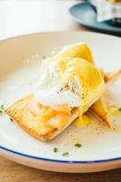 Eggs benedict with smoked salmon for breakfast photo
