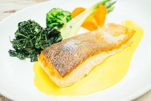 Salmon meat fillet steak in white plate photo