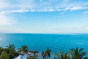 Beautiful sea and beach on blue sky photo