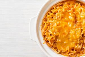 Spicy instant noodle bowl with mozzarella cheese photo