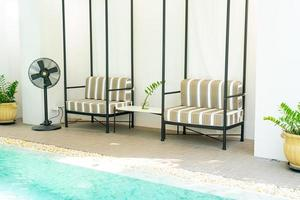 Comfortable pillow decorate on sofa around swimming pool photo