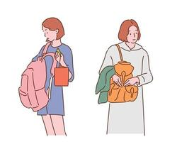 Women are looking for things in a backpack. hand drawn style vector design illustrations.