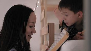Mom reads a book to her child before going to bed video