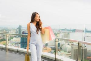 Portrait beautiful young asian woman happy and smile with shopping bag from department store photo