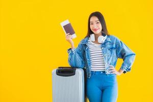 Portrait beautiful young asian woman travel and leisure with luggage bag and passport photo