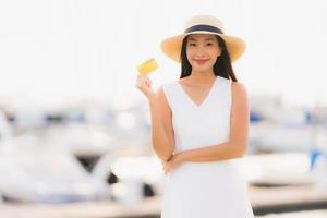 Portrait beautiful young asian woman leisure smile happy relax around yacht port photo