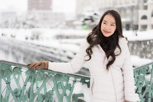 Beautiful young asian woman smile and happy with travel trip in Otaru canal Hokkaido Japan photo