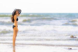 Portrait beautiful young asian woman wear bikini on the beach sea ocean photo