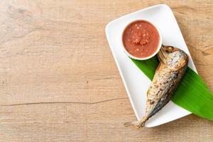 Fried mackerel fish with spicy shrimp paste sauce photo