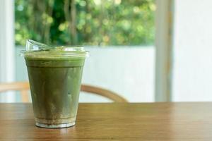 Matcha green tea in a take-away cup photo