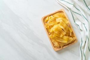 Banana Chips fried or baked sliced banana photo