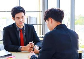 Businessmen sitting in a modern office They are active young businessmen photo