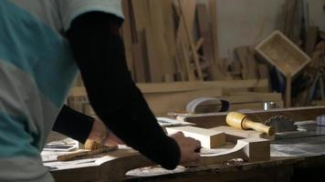 The Carpenter Works with Wood video