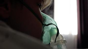 boy makes inhalation at home video