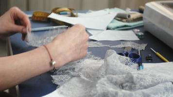 Desktop seamstress designer lingerie side view blue background video