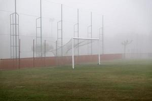 Soccer goal in the fog photo